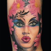 women's face tattoo